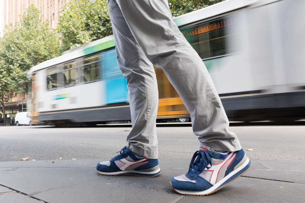 A model posing with Diadora sports shoes in Melbourne